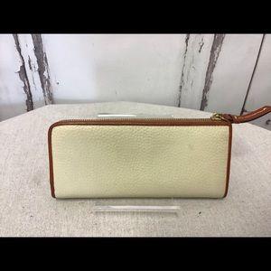 Dooney & Bourke Bags - Dooney & Bourke Cream Pebbled Leather Zip Wallet